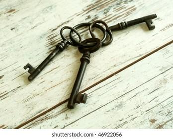 Old rusty keys on wooden boards