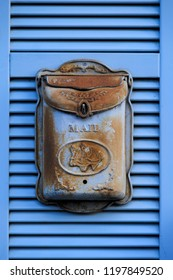 old rusty letter box in blue made from iron