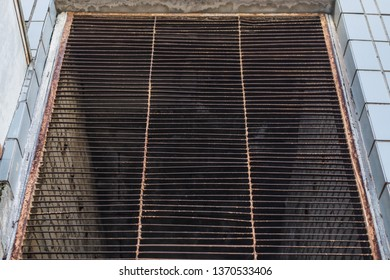Old rusty louvered grill.