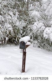 "An old, rusty mailbox covered in snow waits for the mail carrier to come because "" Neither rain, nor sleet, nor gloom of night stays these couriers from the swift completion of their appointed rounds"