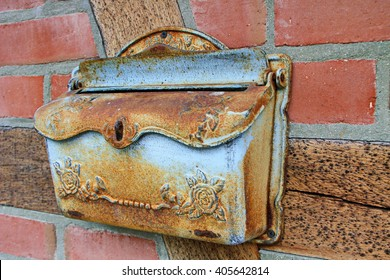 old rusty mailbox on the timbered wall