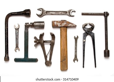 Old rusty mechanic tools isolated on white