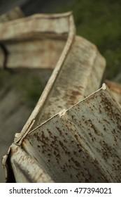 Old, rusty metal barrier