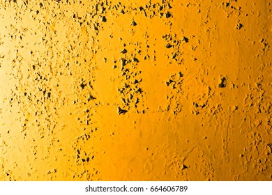 Old rusty metal in golden light as background