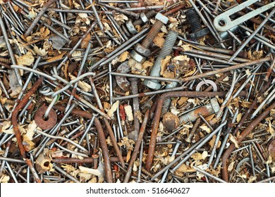 Old rusty metal nails bolts nuts and screws as background