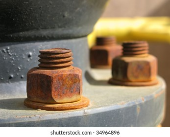 Old rusty metal nut on iron water valve