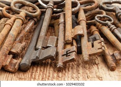 Old rusty metal vintage  keys on  wooden background