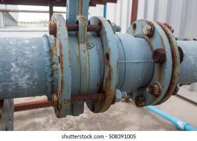 old rusty metal water pipe