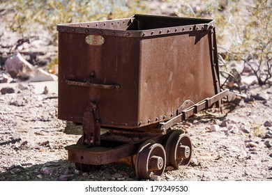 Old rusty mining ore cart in the desert