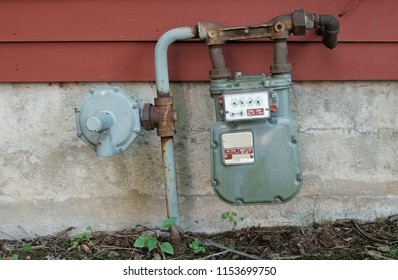 Old Rusty Natural Gas Meter on Side of House