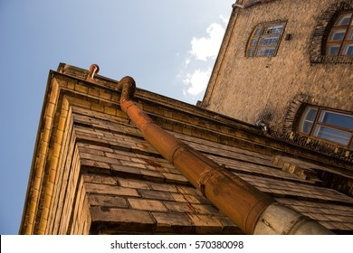 Old rusty pipe leading to roof