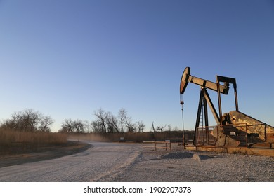 Old rusty pump jack in the oilfield in Texas