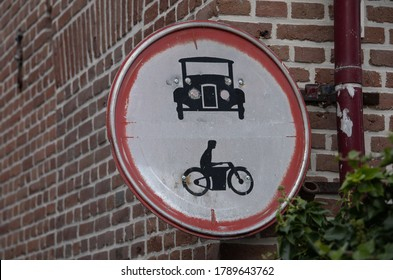 Old rusty roadsign. Forbidden for cars and motorbikes. T-Ford and motor. Netherlands, part of a serie.