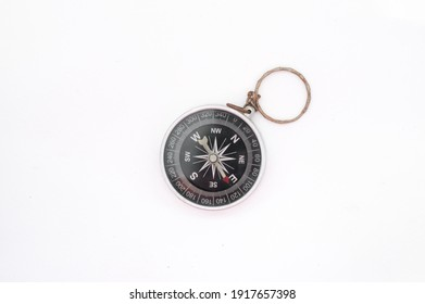 Old rusty round compass on white background.