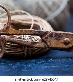 Old rusty scissors on a dark blue background