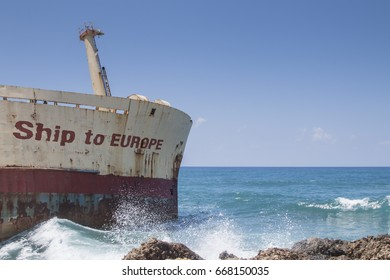 old rusty  shipwreck with the words Ship to Europe, concept for the refugee crisis in the mediterranean sea
