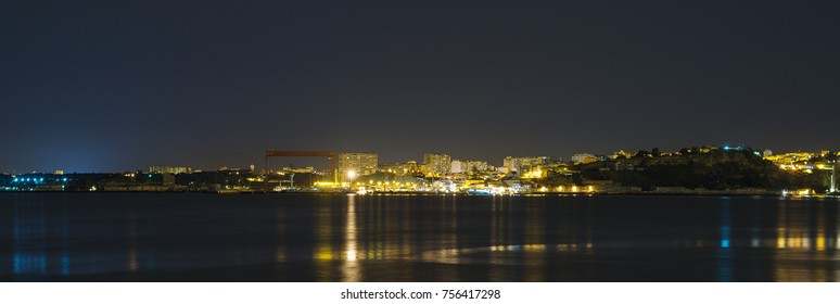 Old rusty shipyard in Portugal at night.