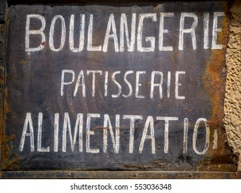 Old rusty sign in french: Bakery and food market