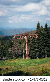 Old rusty ski lift standing on the top of Vysoka hole in Hruby Jesenik, in the Czech mountains on the border with Poland. Abandoned ski transport facility. Nature reserves in the Czech Republic. - Shutterstock ID 1787670812