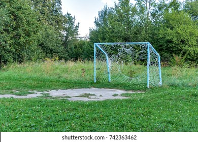 Old rusty soccer goal after game, nostalgia concept.