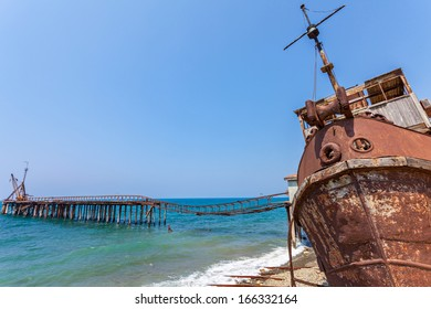 Old rusty steel wreck stranded on a beach in Northern Cyprus