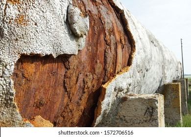 Old rusty tank with falling away pieces of rust