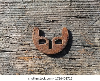 Old rusty thrust washer on wooden background