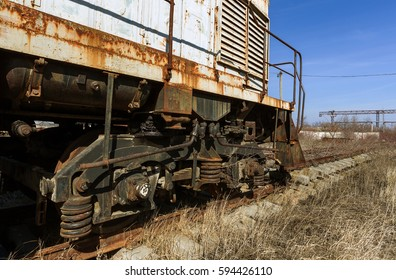Old rusty train locomotive thrown Exclusion zone of Chernobyl. Zone of high radioactivity. Ghost town Pripyat. Chernobyl disaster. Rusty abandoned Soviet machinery in area of nuclear accident at plant