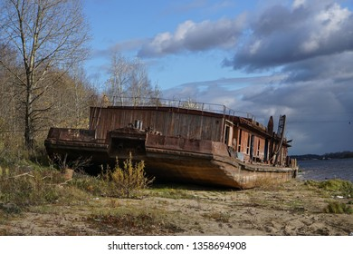 an old rusty tugboat on a shore
