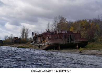 an old rusty tugboat on a shore of Volga river