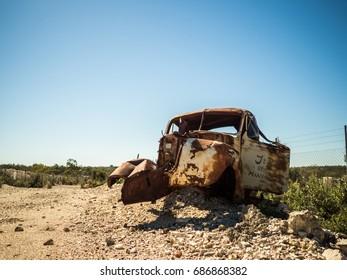 Old Rusty Vintage Car in Desolate Landscape