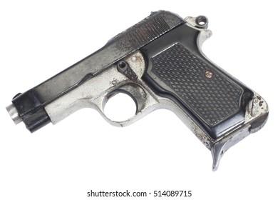Old rusty vintage pistol on white