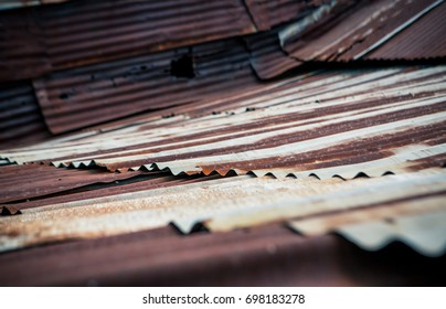 old rusty vintage zinc metal sheet of roof surface as beautiful dark tone abstract backdrop or copy space background, selective soft focus