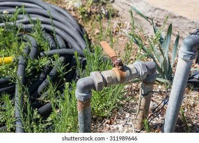 Old rusty water garden tap