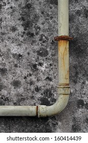 An old and rusty water pipe.
