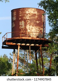 Old Rusty Water Tower in Slidell, Louisiana near an old trading post building from the late 1800s. Early Spanish and French settlers and Native American Indians used a nearby cottage as a trading post