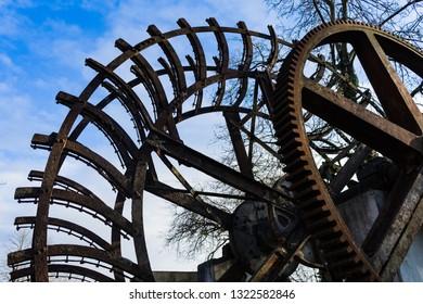 Old rusty waterwheel. No longer in use