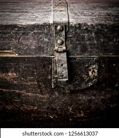 Old rusty wooden coffer closed with dramatic light