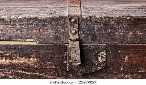 Old rusty wooden coffer closed closeup