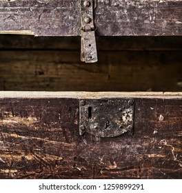 Old rusty wooden coffer opened closeup
