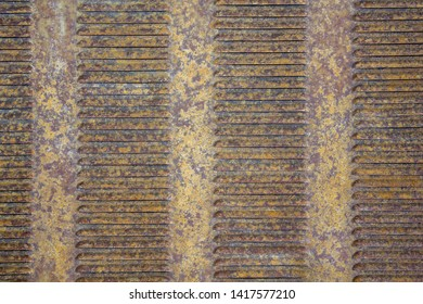 old rusty yellow gray brown metal grille ventilation louvers. rough surface texture