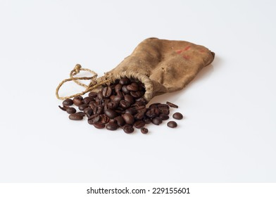 Old sack of coffee beans on white background