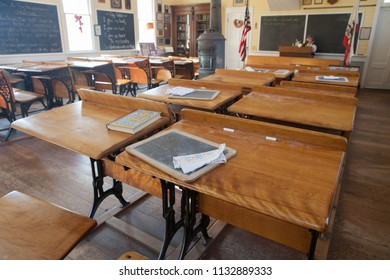 Old Sacramento, CA - February 7, 2013: Historic School House museum in Old Sacramento. These are the desks students used in 1800s.