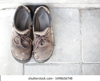 old safety shoes for worker wearing for doing to work in construction work and repairing hard work.