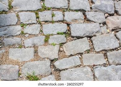 Old sagging to the ground worn cobblestones