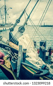 Old sailboat in the harbor, toning