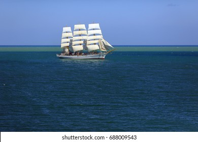 Old sailboat under all sails