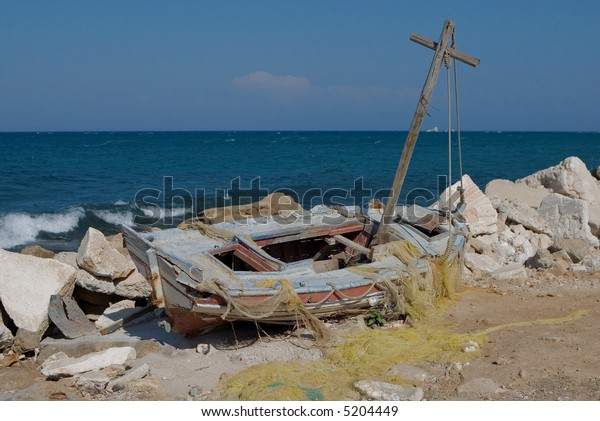 Old sailing boat wreck by the sea in Zakynthos