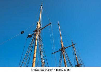 Old sailing ship mast and rope.