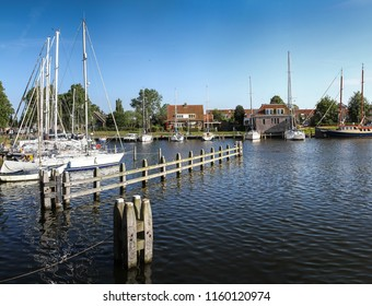 An old sailing ship on the wharf in the Dutch port city of Medemblik, the Netherlands